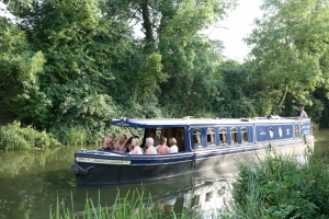 Party of guests enjoying a relaxing, slow, peaceful cruise with good food on board Annie's Launch cruising narrowboat restaurant near Harlow UK