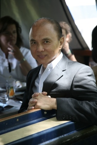Jimmy Choo OBE on the cruising deck of Annie's Launch cruising narrowboat restaurant on Father's Day, with his family