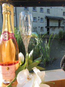 Decorated champagne flute with a bottle of bubbly on Annie's Launch cruising restaurant.
