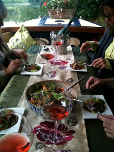 Guests enjoying a aromatic duck on a bed of spinach tossed in truffle oil with wine, on the forward cruising deck of Annie's Launch cruising restaurant near Harlow U.K.